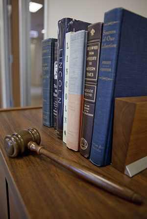 Commercial & Civil Litigation Attorneys: books and gavel